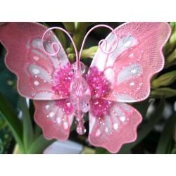 Papillon rose avec perles...