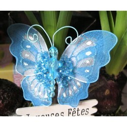 Papillon bleu avec perles...