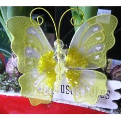 Papillon jaune avec perles...
