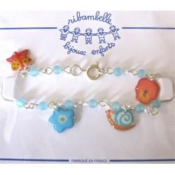 Bracelet perles, fleurs, papillon